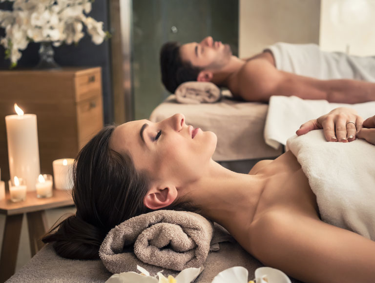 Couple receiving massage